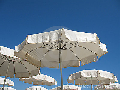Vhite parasols on the beach