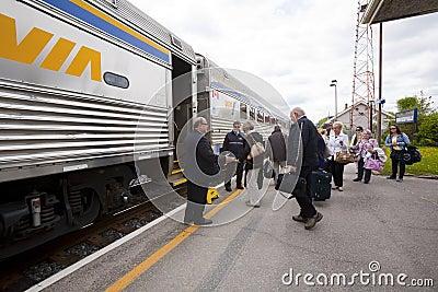 Via Passenger Train Stopped at Station Editorial Photo
