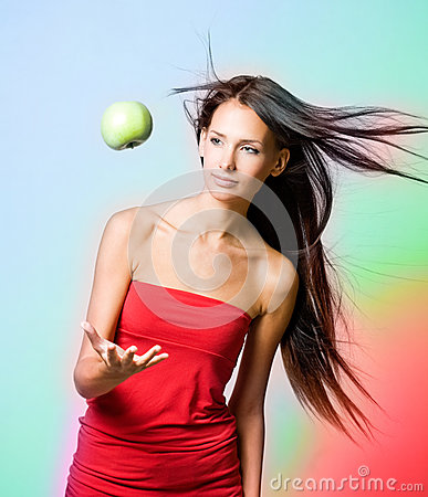 Vibrant healh girl with levitating apple.