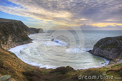 Vibrant sunrise over ocean and sheltered cove