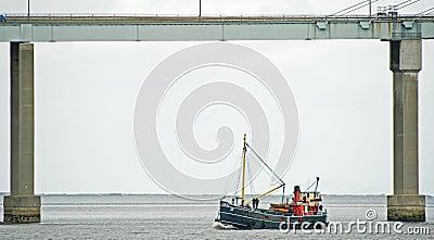 VIC 32 sailing under the Kessock Bridge. Editorial Stock Photo