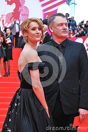 Victoria Isakova and Yuri Moroz at XXXVI Moscow International Film Festival Editorial Stock Image