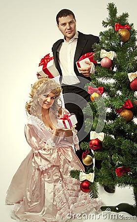 Victorian couple near a Christmas tree