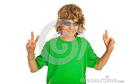 Victory gesturing teen boy