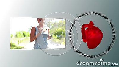 Vidéo d'une femme pulsant avec une animation de coeur banque de vidéos