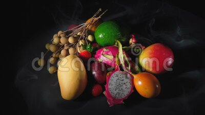 Video of exotic fruits in the smoke. Video of exotic fruits with smoke on black background stock video