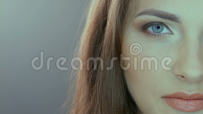 Video portrait of half face of beautiful woman stock video footage