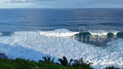 Crashing Surf Against A Palm Covered Cliff In Kauai, Hawaii stock footage