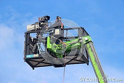 Videographer on crane basket Editorial Image