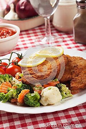 Viener schnitzel, breaded steak with healthy vegetables