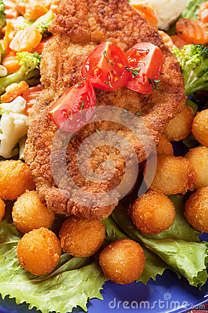 Viener schnitzel, breaded steak with healthy vegetables