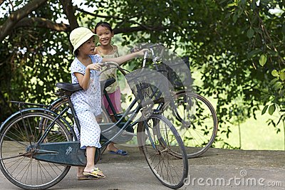 Vietnam Children on Bicycles Editorial Photo