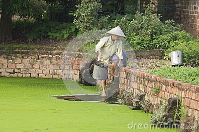 Vietnam Farmer Fetching Water Editorial Photo