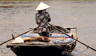 Vietnam, Hoi an: woman going to the market