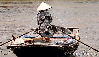 Vietnam, Hoi an: woman going to the market