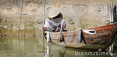 Vietnamese boatman Editorial Stock Photo