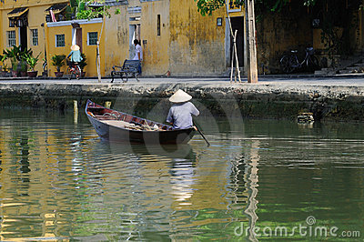 Vietnamese boatman Editorial Stock Photo