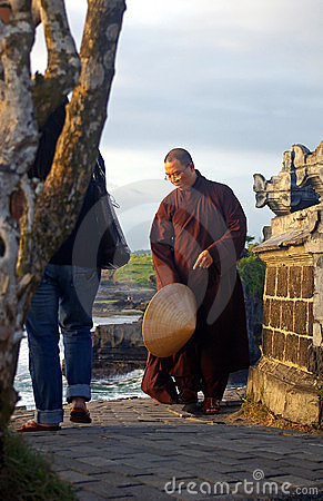 Vietnamese monk at a Balinese temple Editorial Stock Image