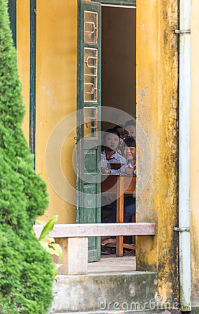Vietnamese School Children Peeking from Classroom Editorial Image