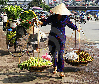 Vietnamese street vendor in Hanoi Editorial Stock Image