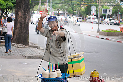 Vietnamese street vendor Selling Drinks Editorial Stock Image