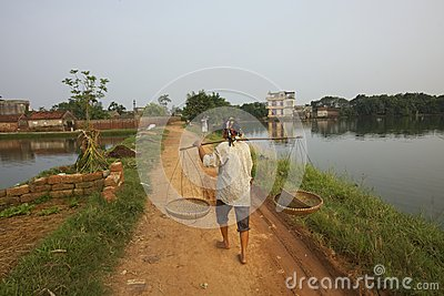 Vietnamese Woman Walking On Path Stock Images - Image: 25210254