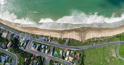 A view from above of the roofs of village houses near the ocean. Shevelev. stock video footage