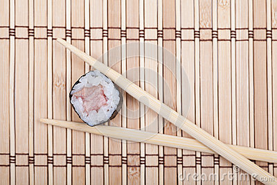 View from above sushi roll on bamboo mat