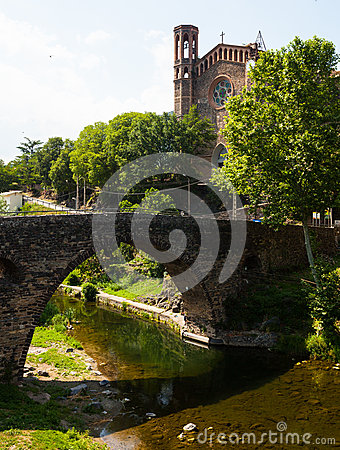 View of ancient church and  bridge in Sant Joan les Fonts