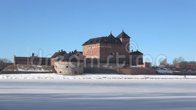 View of the ancient fortress of Hameenlinna, March afternoon. Finland. View of the ancient fortress of Hameenlinna on the shore of lake Vanajavesi, March stock video footage