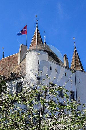 Free View At Nyon Castle With Flag Waving On The Roof Through Blooming Tree Royalty Free Stock Photo - 116490395
