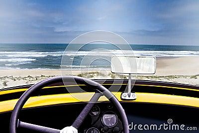 View of a beach inside an old convertible car