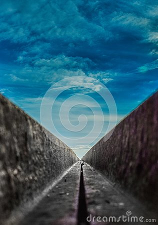 View from the bridge, old broken rusty bridge over the sea, beautiful view to the sky Stock Photo