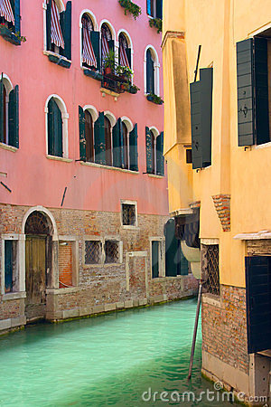 View of Canal in Venice with pink and yellow house