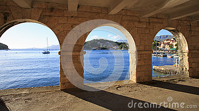 View of Cavtat shoreline through arches