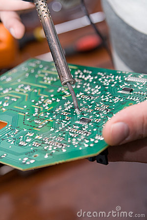 View of a circuit board being repaired.