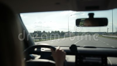 View on curvy road from car`s interior stock footage