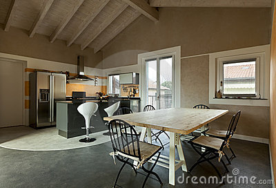 View of dining table and kitchen