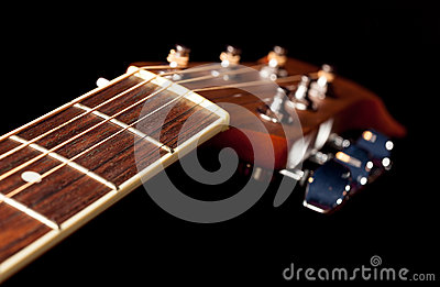 View down the fretboard of guitar