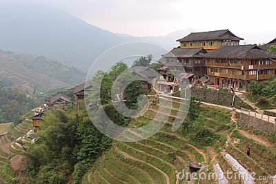 View with Dragon Ridge Terrace of rice fields and wood house