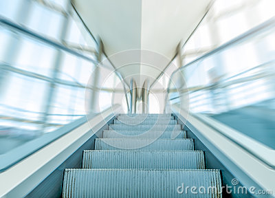 View of escalator in business centre in motion.
