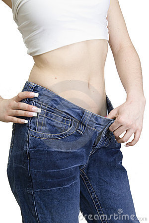 View of female became skinny and wearing old jeans