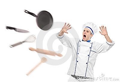 A view of flying kitchen utensils towards chef