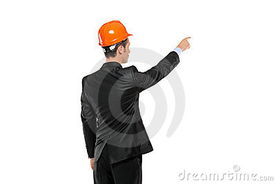 A view of a foreman in a suit pointing