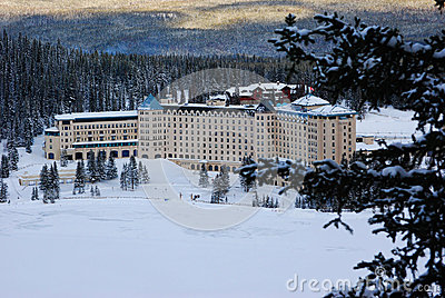 View of frozen lake and famous hotel in National Park, Canada
