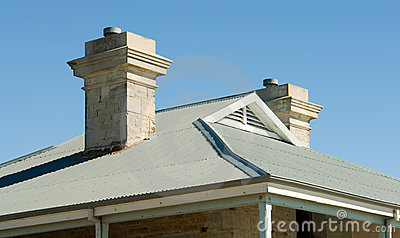 View of house roof line with view to blue sky