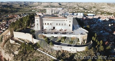 View of impressive medieval castle of Order of Calatrava on hill in town of Alcaniz, Spain. Aerial view of impressive medieval castle of Order of Calatrava on stock video footage