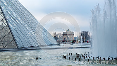View of the Louvre pyramid in Paris Editorial Stock Photo