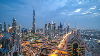 View on modern skyscrapers and busy evening highways day to night timelapse in luxury Dubai city, Dubai, United Arab. View on modern skyscrapers and busy evening