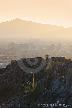 View of mountains surrounding Phoenix at sunset, A